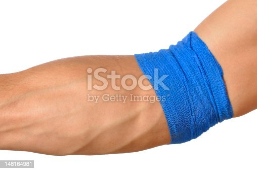 Closeup of arm wrapped at elbow with blue bandage on white background