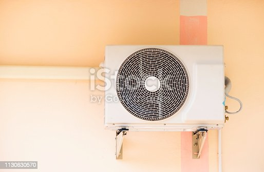 871063730istockphoto Compressor air conditioner mounted outdoor for the house. 1130630570