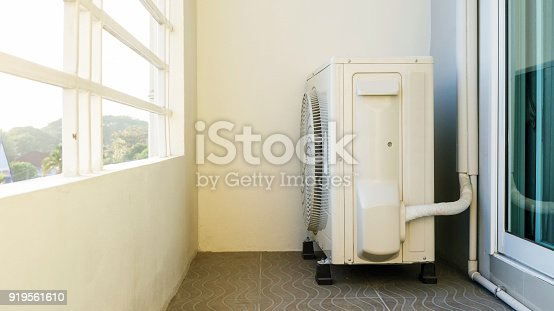 1132460292 istock photo Compressor air conditioner on a balcony of a room. 919561610