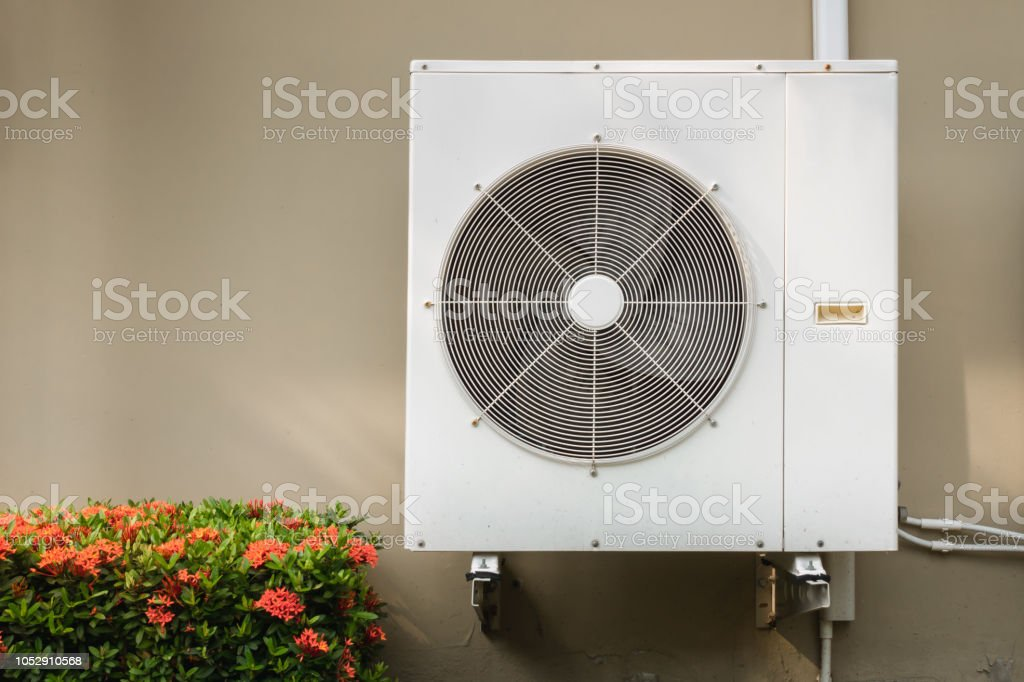 Compressor air conditioning system installation embedded on wall of building. stock photo
