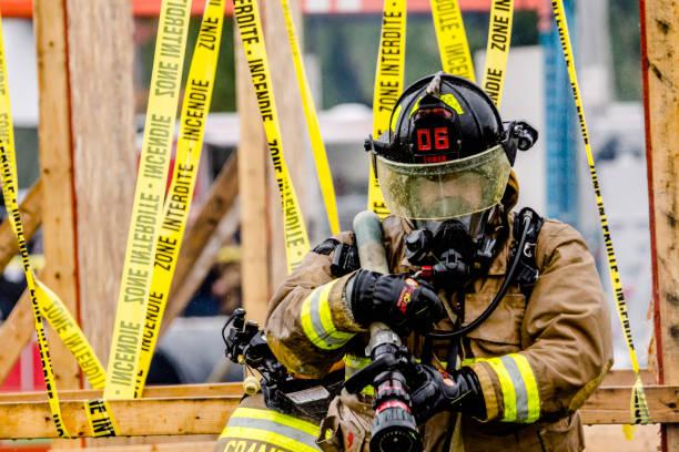 Compétition Extreme de pompiers. stock photo