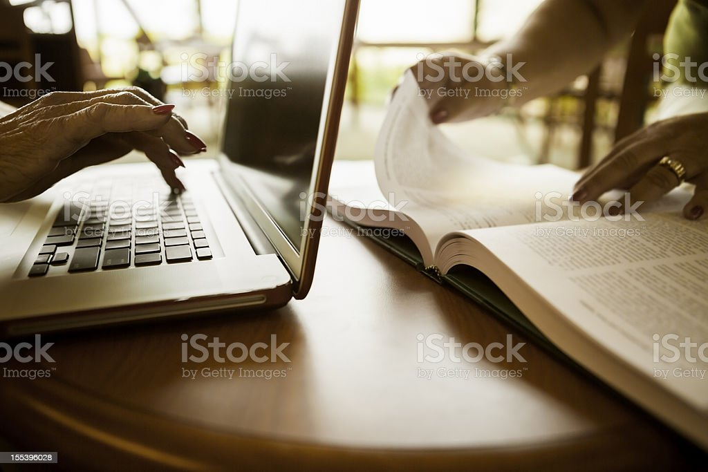 Computer and Book in Library royalty-free stock photo
