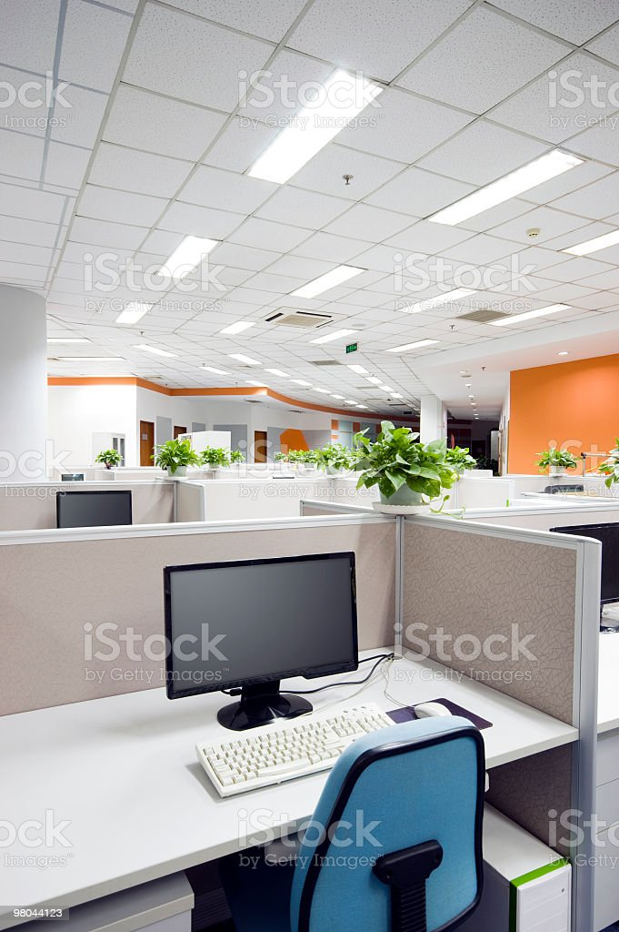 Computer and chair in a cubicle in an office workplace royalty-free stock photo