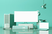 istock Computer and loptop white screen with many gadgets on teble in pastel green tone. 3d rendering 1178984283
