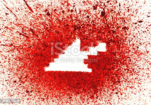 istock Computer arrow shape over red splashes 806175934