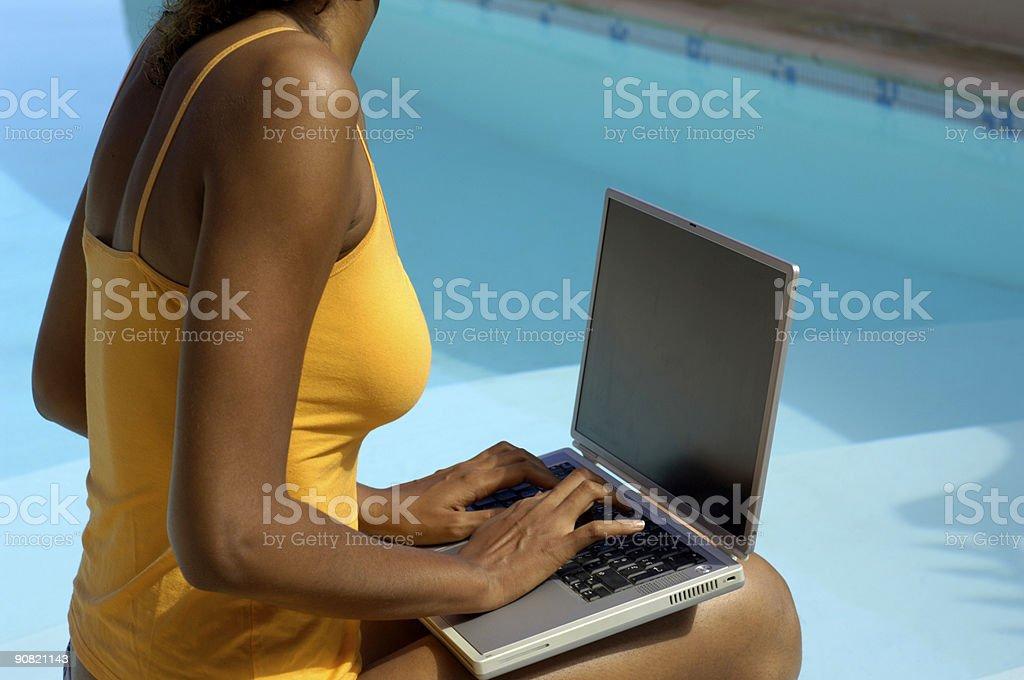 computer at swimming pool 2 stock photo