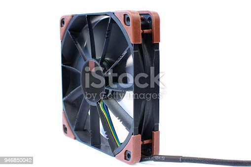 istock Computer black fan isolated on white background. Quiet cooling component of pc with anti-vabration pads. Hardware cooler in action 946850042