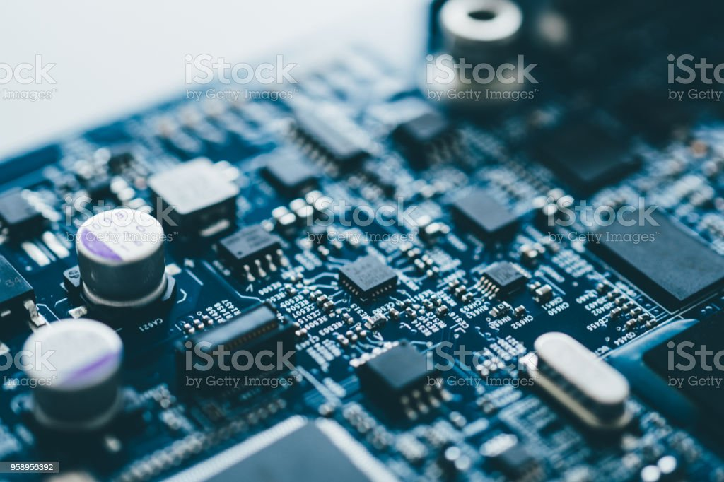 Computer board hardware motherboard microelectronics Server CPU chip semiconductor circuit core blue technology background or blue texture with processors concept electronic device stock photo