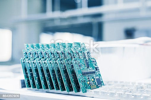 istock Computer boards. Computer techologies. Spare parts. Computer parts manufacturing plant. 854352926