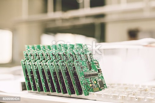 istock Computer boards stand in a row at the factory for the production of spare parts. 839996404