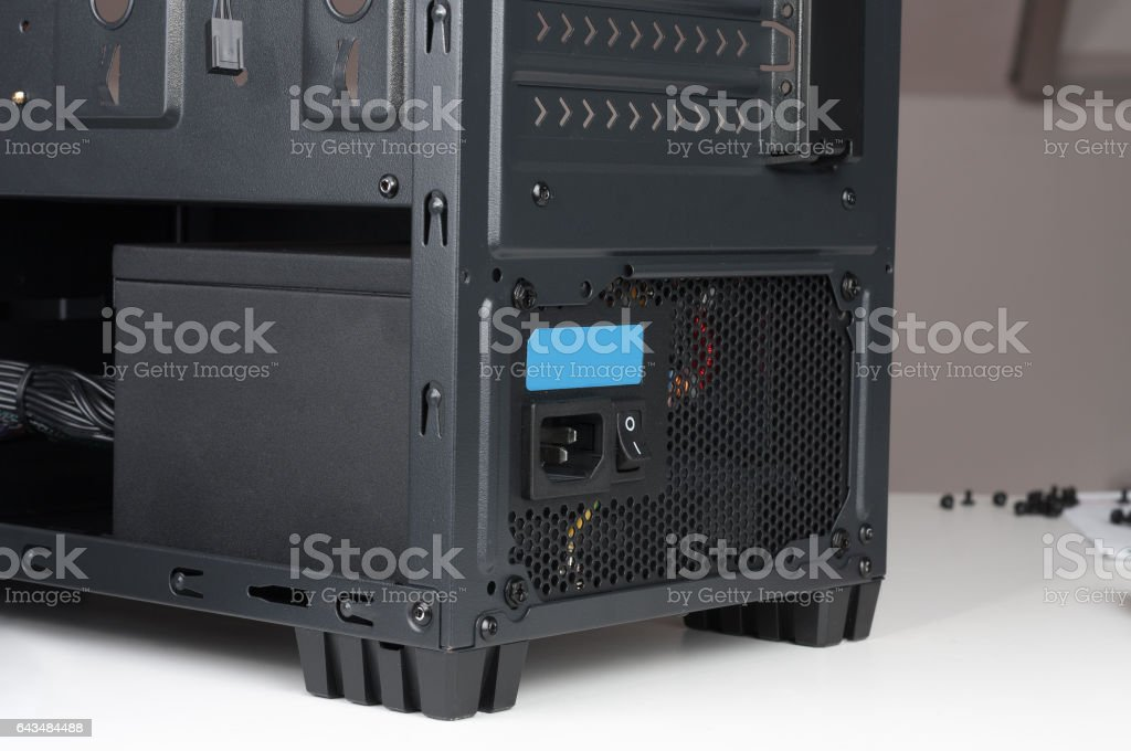 Computer case, midi tower  with inserted power supply stock photo