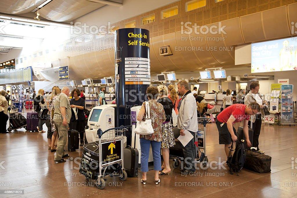 Checking in at Arlanda Airport Stockholm, Sweden. Passengers waiting,...