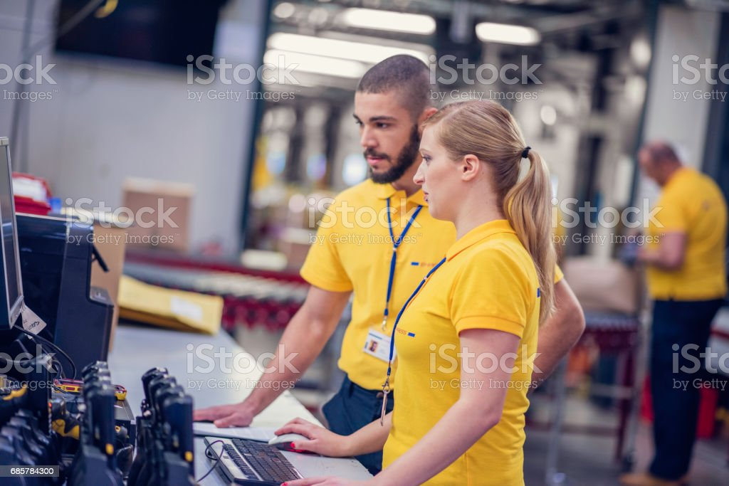 Computer checking in warehouse royalty-free stock photo