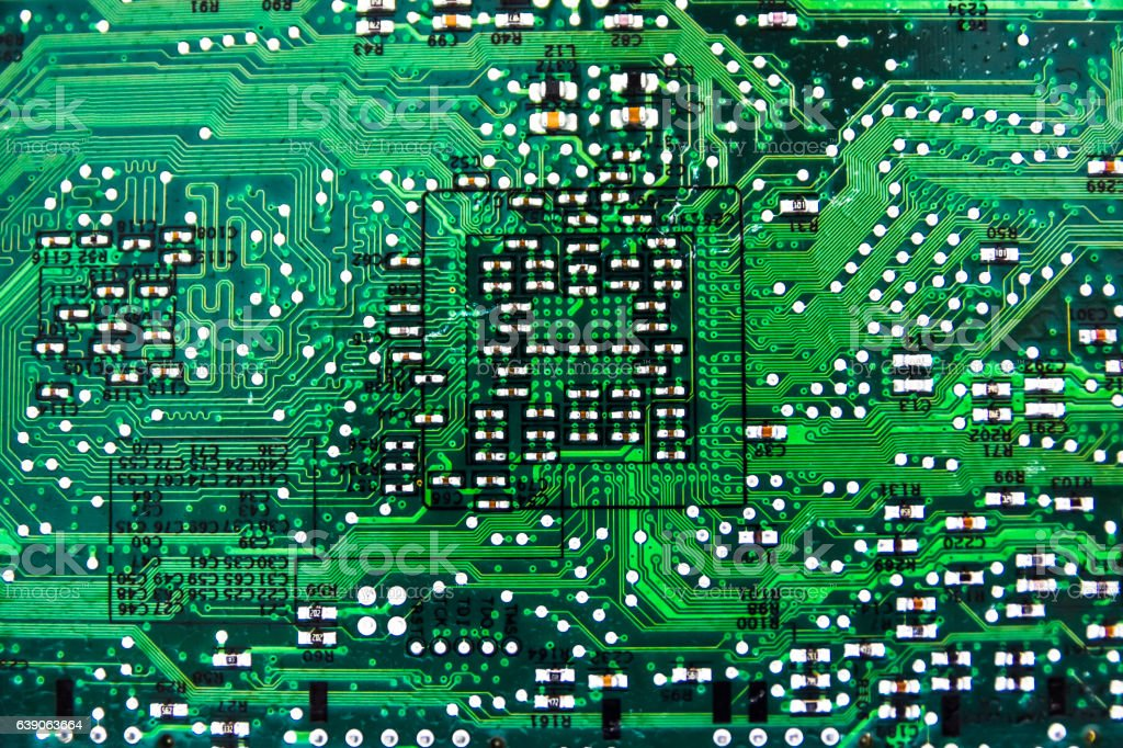 computer circuit board close up as abstract electronic background green royalty free