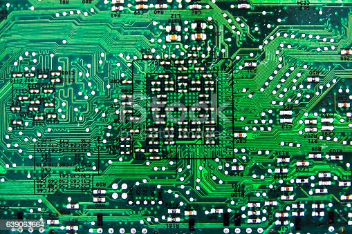 486162999istockphoto Computer circuit board close-up as abstract electronic background. Green. 639063664