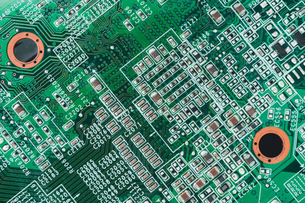 computer circuit board. high technology - capacitor stock photos and pictures