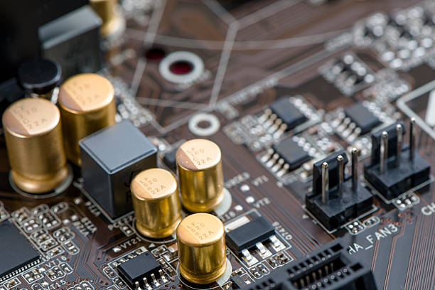 computer circuit board - capacitor stock photos and pictures