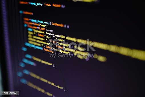 Close up of a program code on a computer screen. Technology, coding, programming, it, software development and hacking concept.