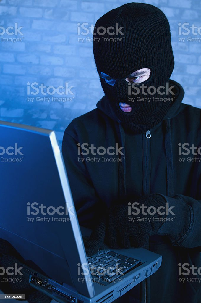 Computer crime committed by a hacker at night royalty-free stock photo