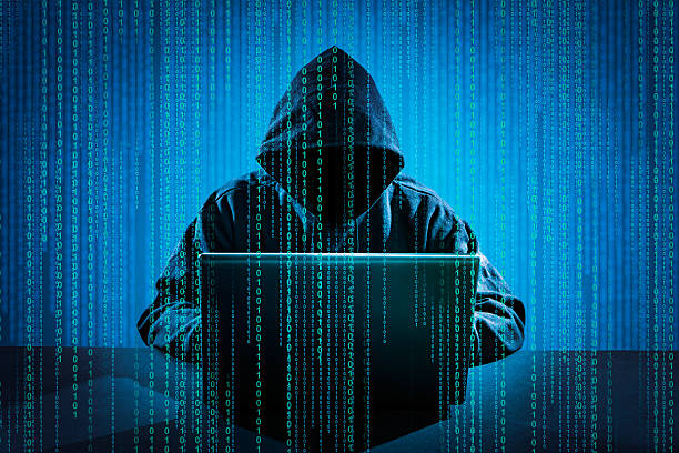 Computer crime concept. Hacker using laptop. Hacking the Internet. computer crime stock pictures, royalty-free photos & images