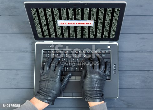 istock Computer Criminal using brute force password break 840176988