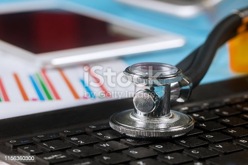 istock Computer data analysis stethoscope over a laptop computer keyboard used digital pro tablet 1156360300