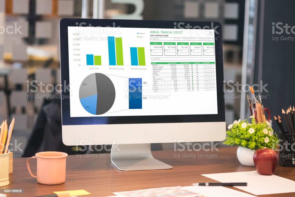 Computer desktop on office table showing charts and graph against office background,Computer Analysis Business, Statistics Concept. stock photo