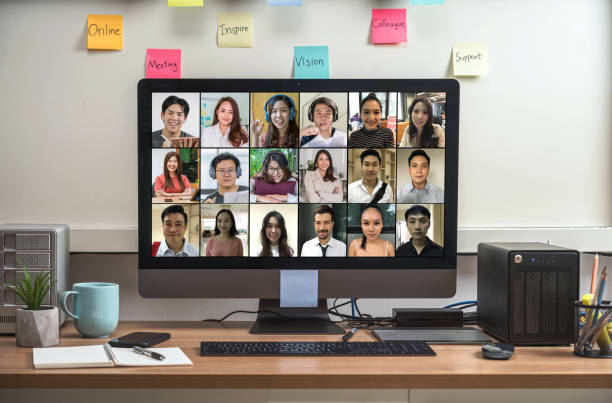 Computer desktop with Stationery and device showing the diversity people with their friend via video conference