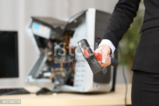 593328060istockphoto Computer destroyed by a businesswoman 622183776