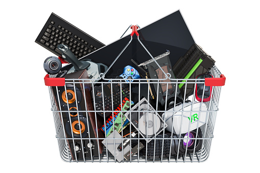 istock Computer device and accessories inside shopping basket, 3D rendering isolated on white background 1067491622