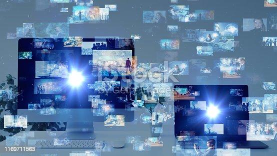 istock Computer display and hologram screens. Streaming video. Social media. 1169711563
