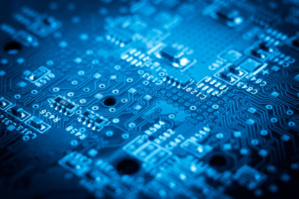 computer electronic microcircuits. macro. blue - mother board stock pictures, royalty-free photos & images