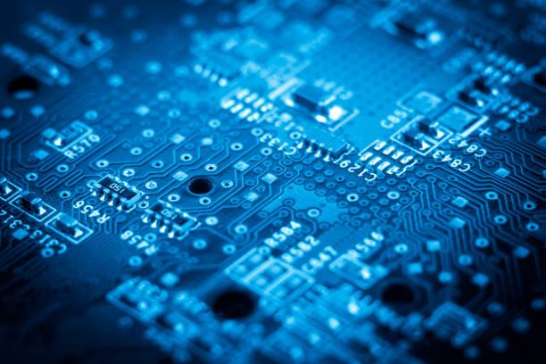 computer electronic microcircuits. macro. blue - scheda a circuito foto e immagini stock