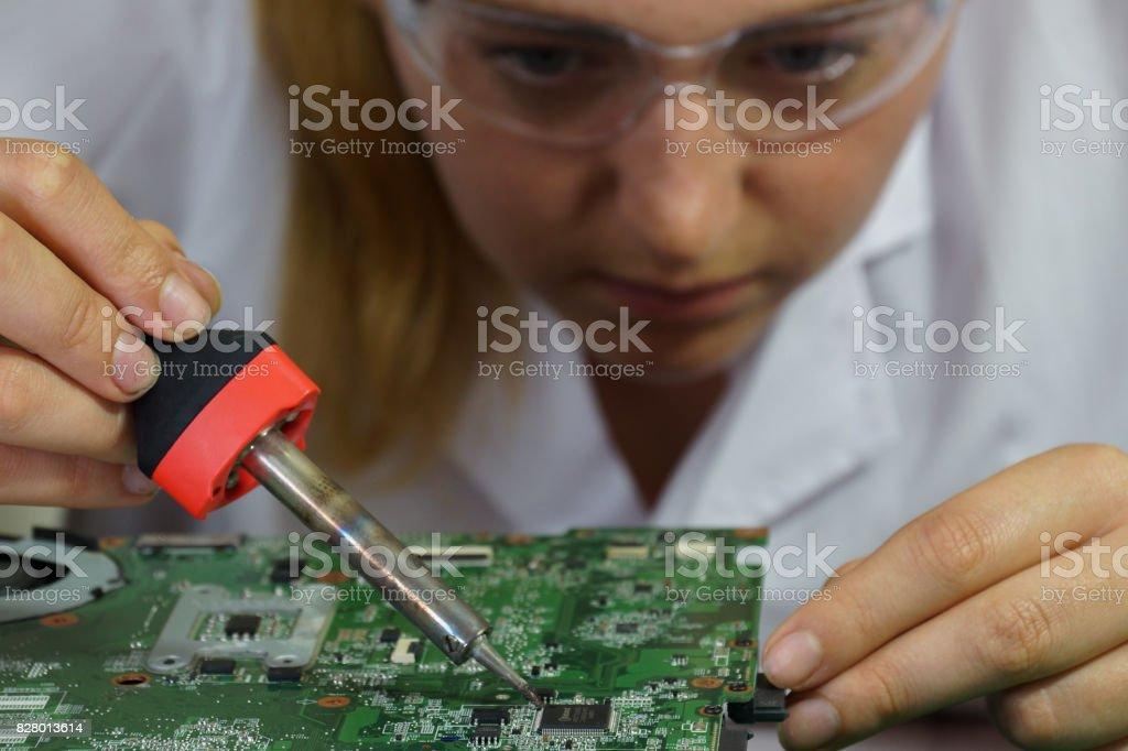 A computer engineers works on a computer circuit board stock photo