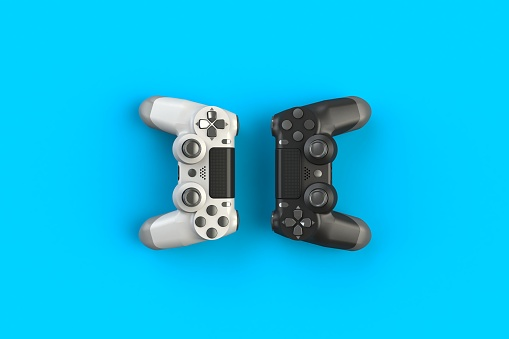 istock Computer game competition. Gaming concept. White and black joystick isolated on blue background, 3D rendering 916017182