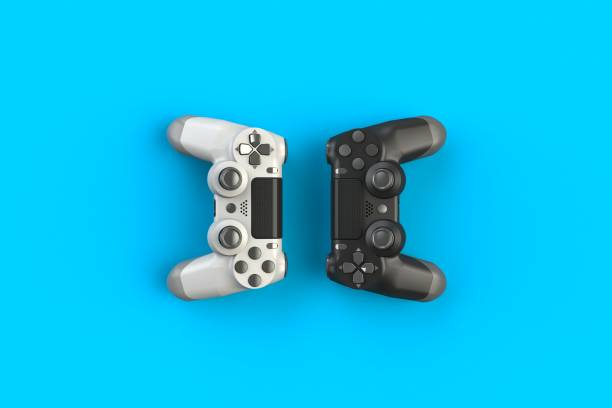 Computer game competition. Gaming concept. White and black joystick isolated on blue background, 3D rendering Computer game competition. Gaming concept. White and black joystick isolated on blue background, 3D rendering gamepad stock pictures, royalty-free photos & images