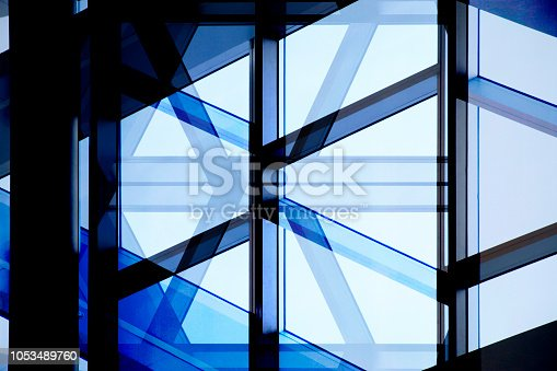 istock Computer graphic image of glass wall with metal framework. Structural glazing. Futuristic public or office building fragment against blue sky. Abstract modern architecture background. 1053489760