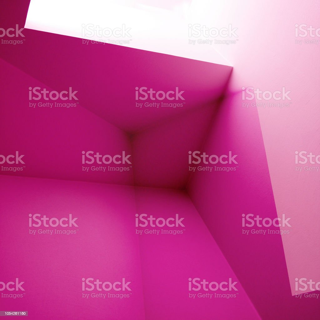 Computer graphic image of walls and ceiling. Polygonal structure of corners / angular shapes in shades of magenta color. Abstract background on the subject of modern architecture or interior. stock photo