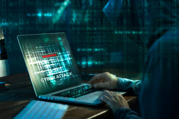 Computer hacker. Internet crime working on a code on laptop screen with dark digital background. Cyber attack in cyberspace concept stock photo