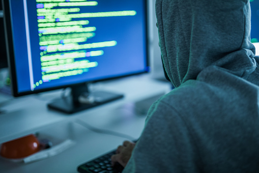 Computer Hacker Stealing Computer Software In The Office Stock Photo - Download Image Now