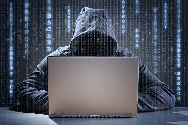 computer hacker stealing data from a laptop - hacker stock photos and pictures