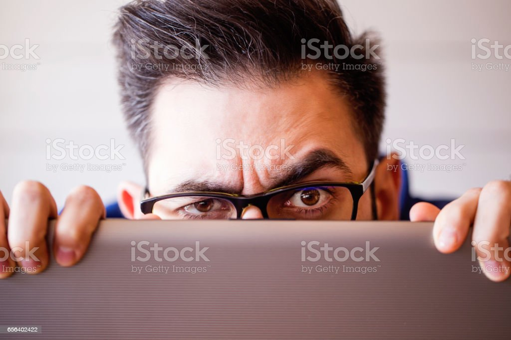 Computer hacker stealing information with laptop - foto stock