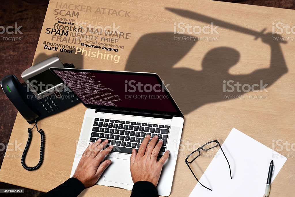 computer hacker versus antivirus software protection stock photo