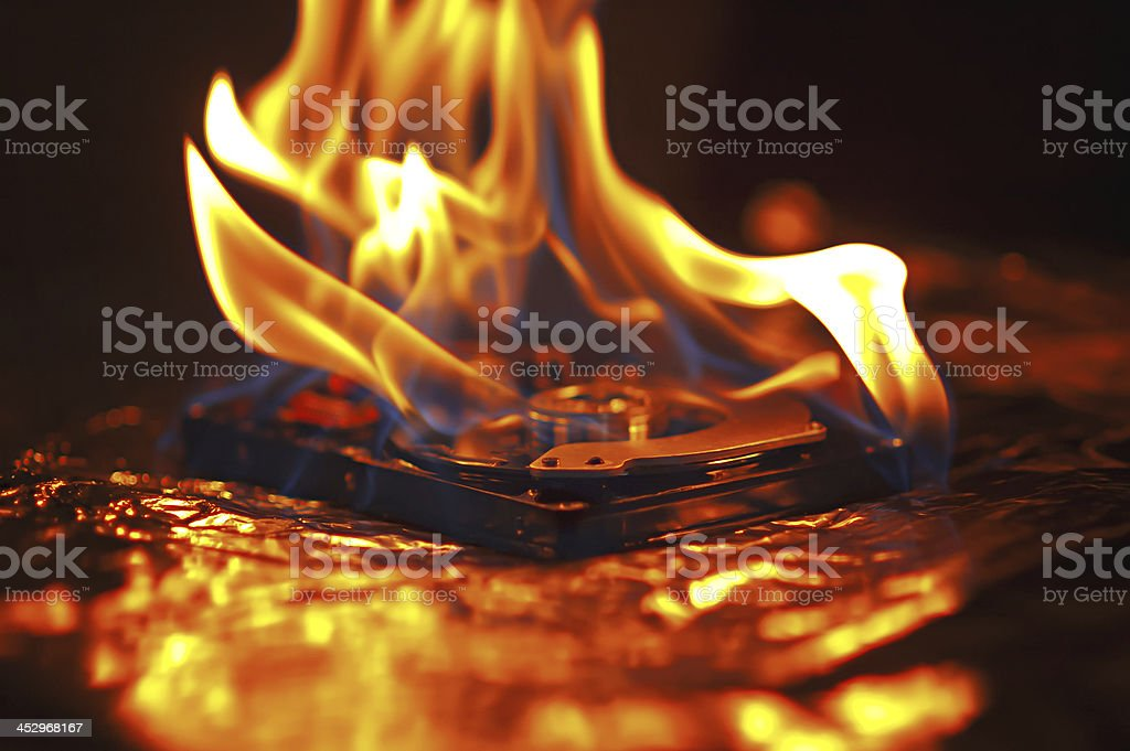 Computer hard disk on fire stock photo