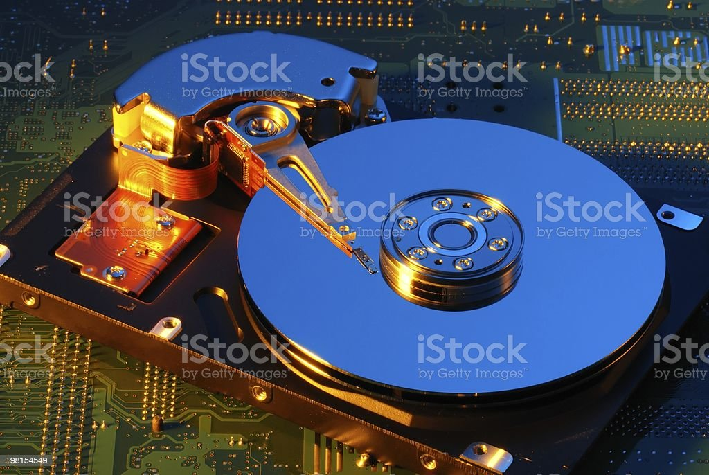 Computer Hard Drive with Motherboard in Background royalty-free stock photo