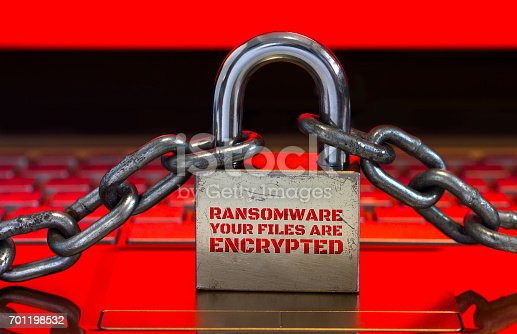 istock Computer has been blocked access to Data with Ransomware.Can not access Data by Malware,Encrypt and Hacking Conceptual with Padlock.The Old padlock and Chains On Laptop with Red Screen. 701198532