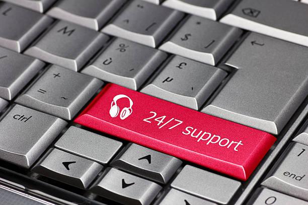 Tecla de Computador-atendimento 24/7 com o ícone de fone de ouvido - foto de acervo
