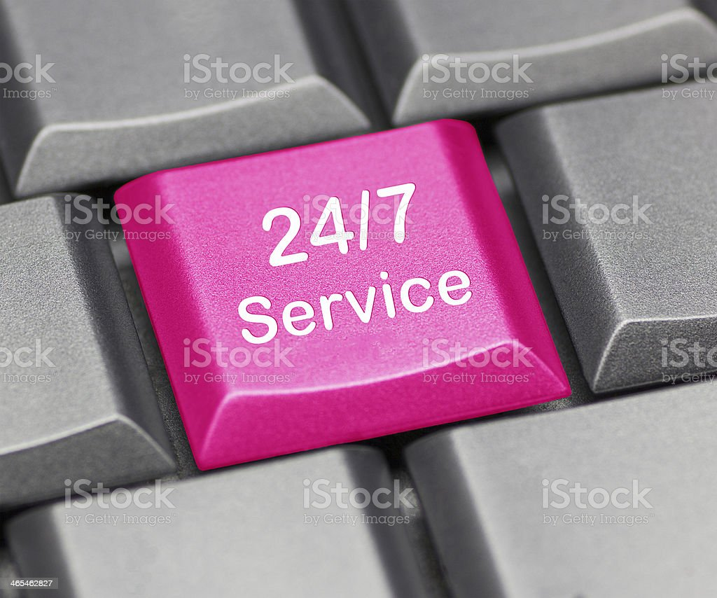 Computer key pink - 24/7 service stock photo