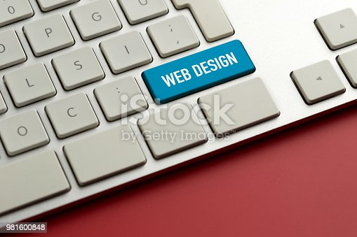 istock Computer key showing the word WEB DESIGN 981600848