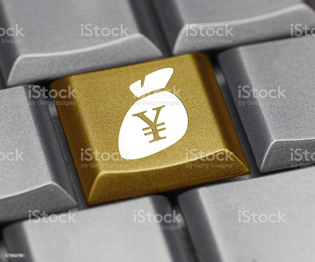 Computer key with Yen sign and purse royalty-free stock photo
